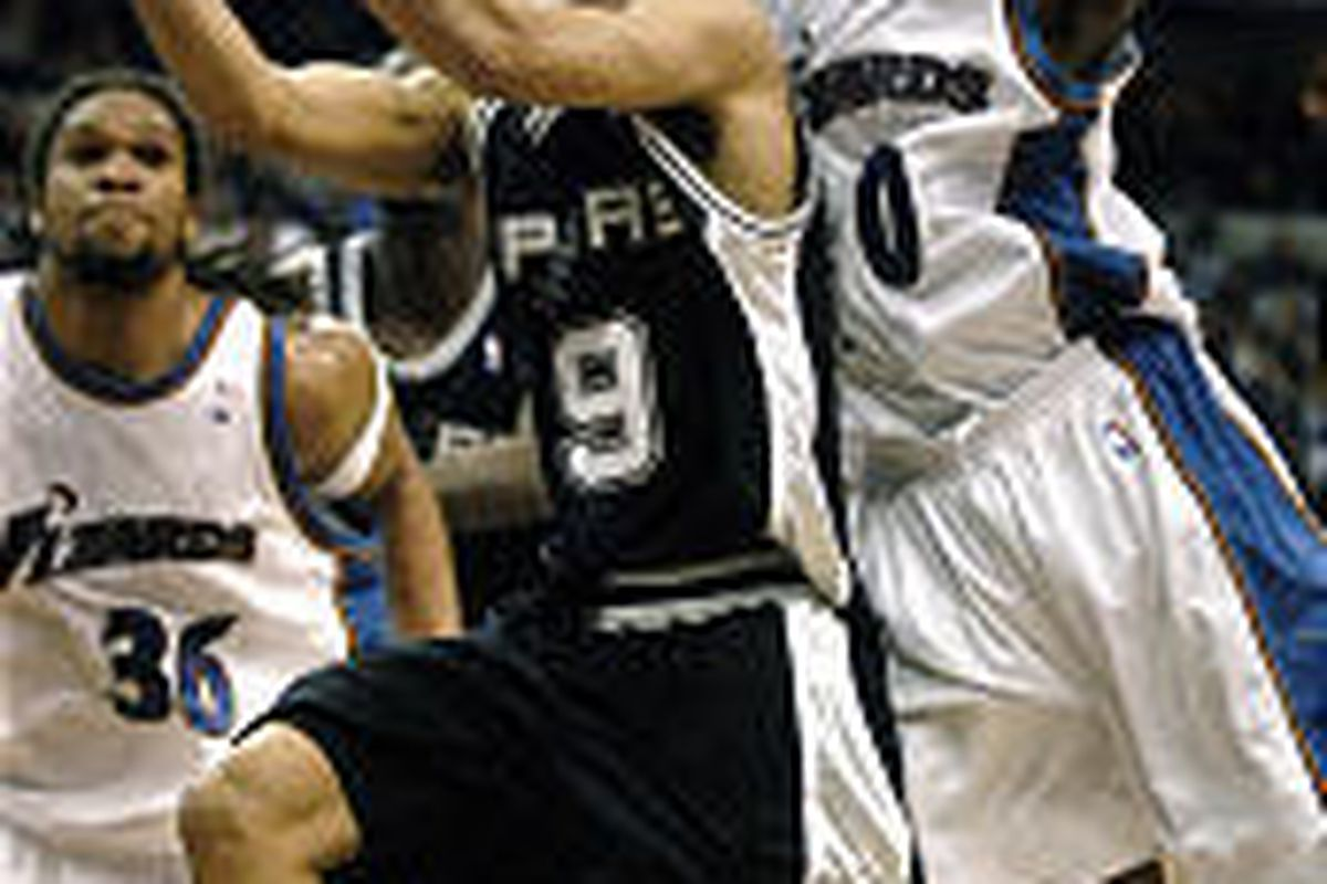 Wizards' Gilbert Arenas, right, tries to block shot of Spurs' Tony Parker in Saturday's game.