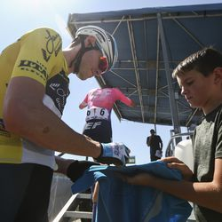 Israel Cycling Academy rider Ben Hermans signs a shirt for Mark Mumm, 10, before Stage 3 of the Tour of Utah on Antelope Island on Thursday, Aug. 15, 2019.