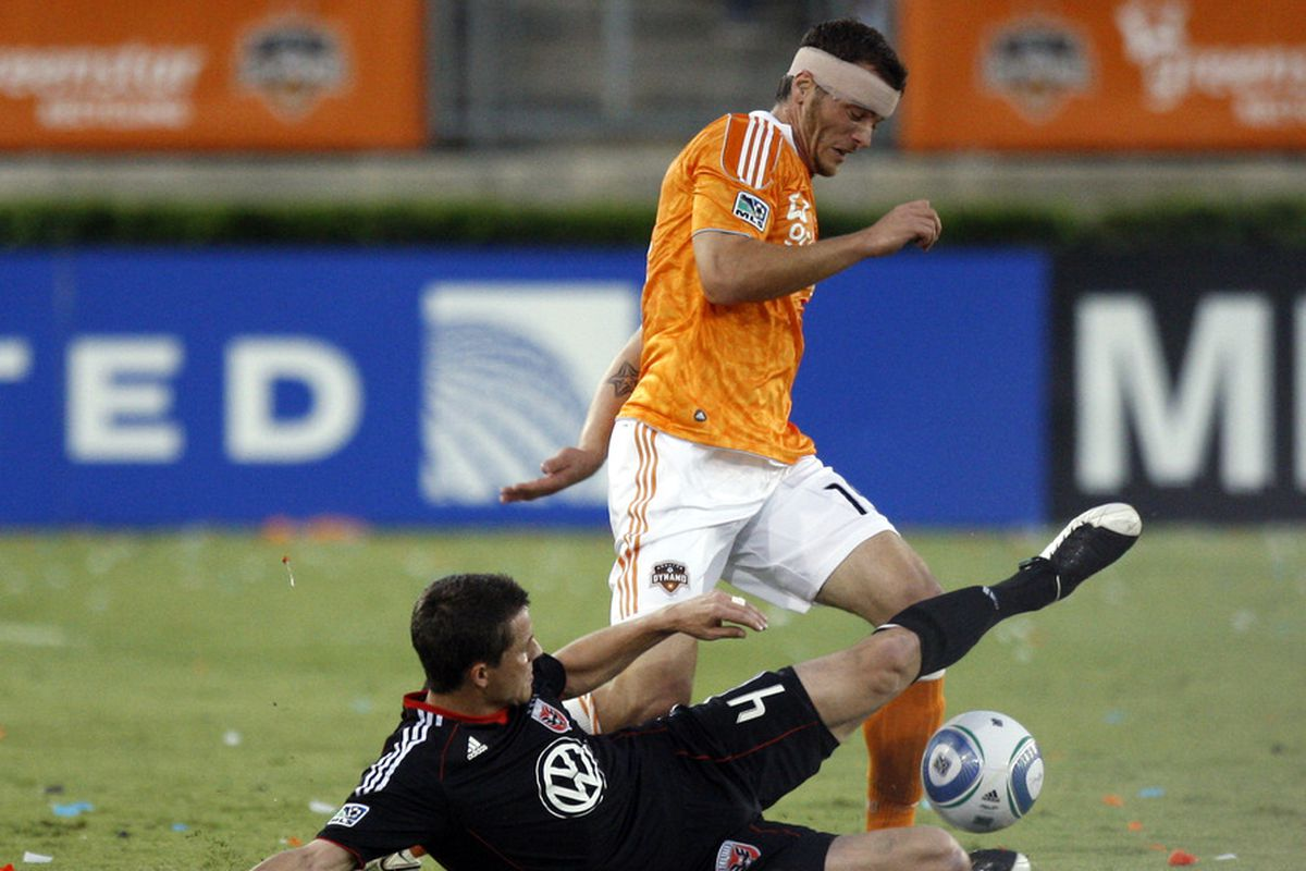 HOUSTON - APRIL 29:  Cam Weaver #15 of the Houston Dynamo dribbles past a sliding Marc Burch #4 of D.C. United at Robertson Stadium on April 29, 2011 in Houston, Texas.  (Photo by Bob Levey/Getty Images)