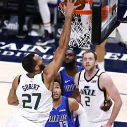 Utah Jazz center Rudy Gobert (27) dunks over Dallas Mavericks guard Jalen Brunson (13) as the Utah Jazz and the Dallas Mavericks play an NBA basketball game at Vivint Smart Home Arenain Salt Lake City on Wednesday, Jan. 27, 2021. Jazz won 116-104.
