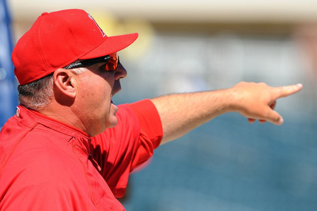 Mar 20, 2012; Surprise, AZ, USA; Los Angeles Angels manager Mike Scioscia (14) prior to the game against the Kansas City Royals at Surprise Stadium. Mandatory Credit: Christopher Hanewinckel-US PRESSWIRE
