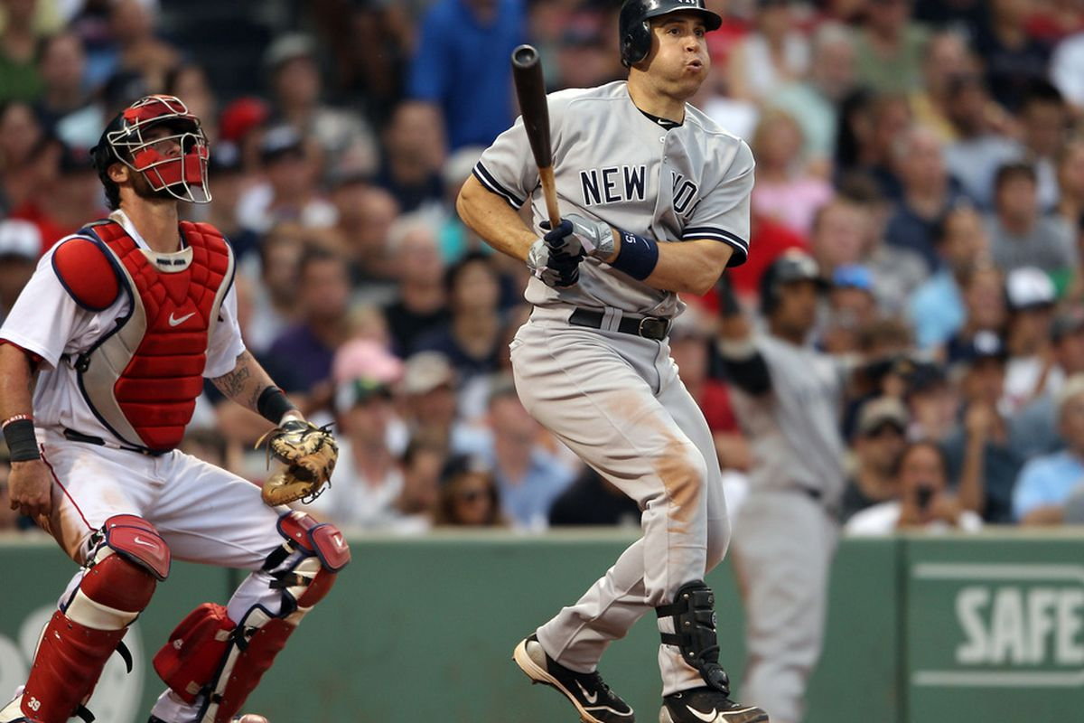 BOSTON, MA - AUGUST 06: Mark Teixeira #25 of the New York Yankees hits a solo home run as Jarrod Saltalamacchia #39 of the Boston Red Sox defends  on August 6, 2011 at Fenway Park in Boston, Massachusetts.  (Photo by Elsa/Getty Images)