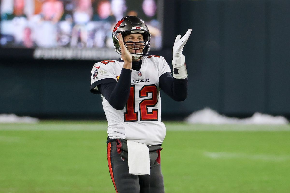 Tom Brady of the Tampa Bay Buccaneers celebrates in the fourth quarter against the Green Bay Packers during the NFC Championship game at Lambeau Field on January 24, 2021 in Green Bay, Wisconsin.
