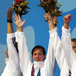 Salt Lake City native Courtney Johnson is at center of this group after winning the silver medal in water polo with the United States team at the 2000 Olympics.