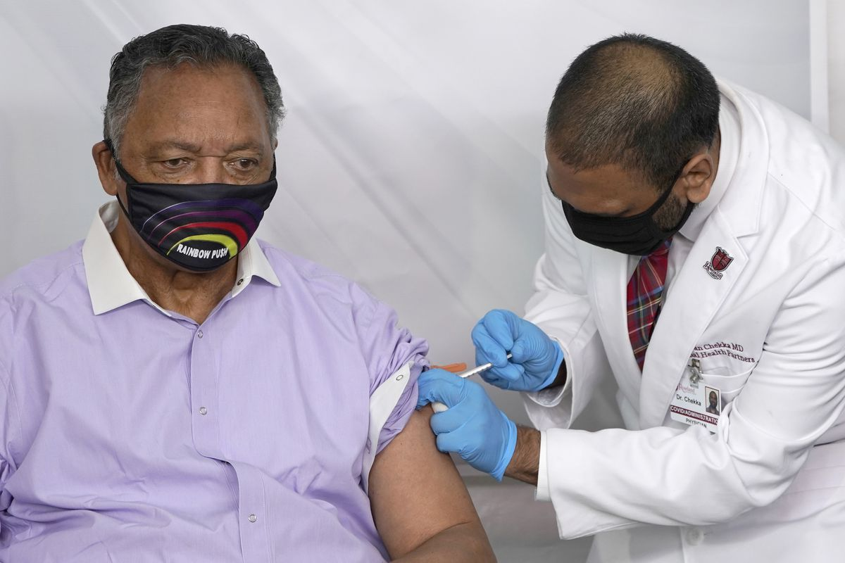 FILE - In this Friday, Jan. 8, 2021, file photo, Rev. Jesse Jackson Sr. receives the Pfizer's BioNTech COVID-19 vaccine from Dr. Kiran Chekka, Jackson and his wife, Jacqueline, have been hospitalized after testing positive for COVID-19 according to a statement Saturday, Aug. 21, 2021. He is vaccinated against the virus and publicly received his first dose in January. According to a statement released Saturday evening, the Jacksons are being treated at Northwestern Memorial Hospital in Chicago. He is 79 years old. Jacqueline Jackson is 77. (AP Photo/Charles Rex Arbogast, File) ORG XMIT: NY115