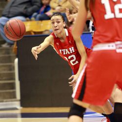 Utah's Danielle Rodriguez passes the ball during a women's basketball game against BYU at the Marriott Center in Provo on Saturday, Dec. 14, 2013. Utah won in double overtime 82-74.