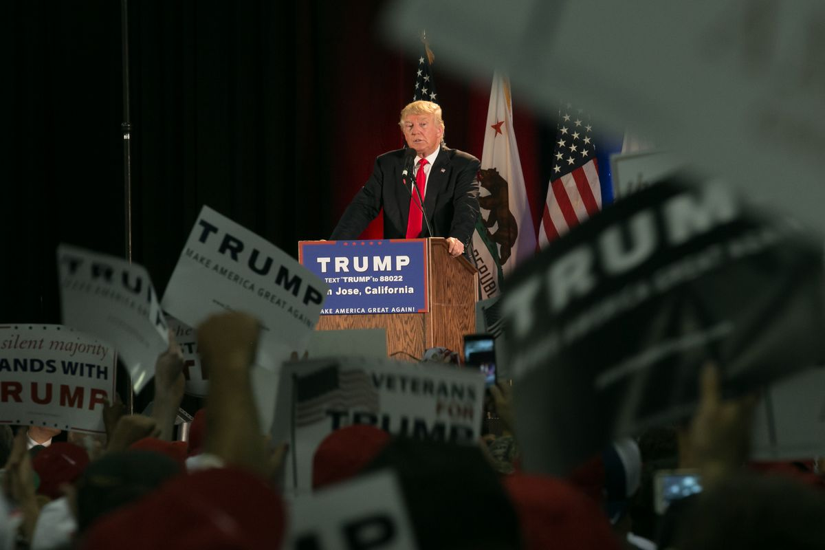 Then-presidential candidate Donald Trump stands at a podium at a campaign rally in San Jose, California, in 2016.