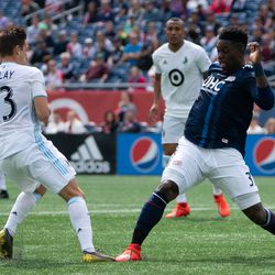 FOXBOROUGH, MA - MARCH 30: New England Revolution defender Jalil Anibaba #3 pokes the ball away from Minnesota United FC midfielder Ethan Finlay #13 during the first half at Gillette Stadium on March 30, 2019 in Foxborough, Massachusetts. (Photo by J. Alexander Dolan - The Bent Musket)