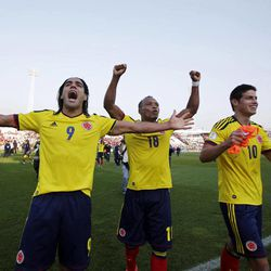 Colombia's players Ramadel Falcao, left, Camilo Zuniga, center, and James Rodriguez celebrate their victory over Chile at a World Cup 2014 qualifying soccer game in Santiago, Chile, Tuesday, Sept. 11, 2012. Colombia won 3-1.