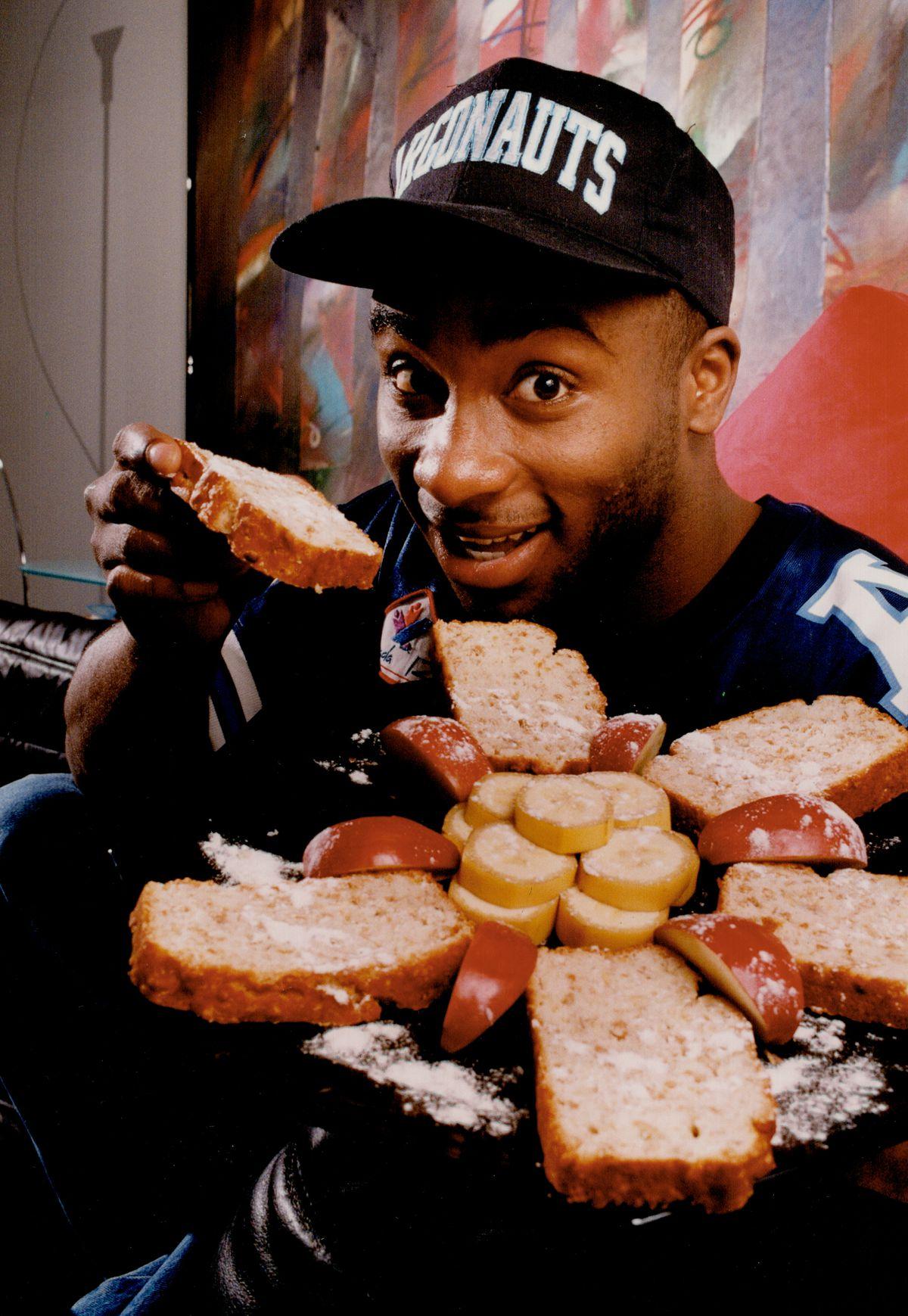 Rocket fuel: Raghib Ismail; the Toronto Argonauts star quarterback; chows down on some tasty banana