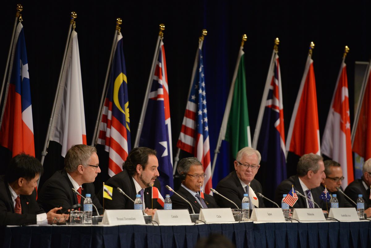 Trade representatives attend an October 2014 TPP press conference in Sydney.