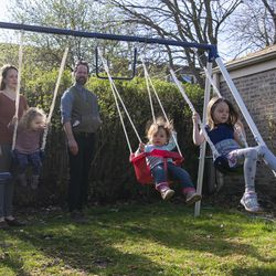 The Anderes family enjoys time together on the swing set, Thursday, April 30, 2020.