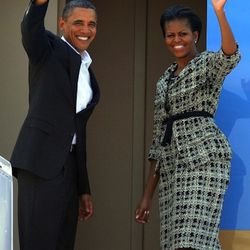 In a <b>Nina Ricci</b> suit, departing on Air Force One from Mumbai, India on November 7, 2010