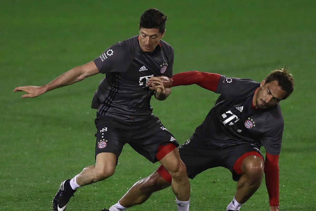 Robert Lewandowski is challenged by Mats Hummels during a training session at day 5 of the Bayern Muenchen training camp at Aspire Academy on January 7, 2017 in Doha, Qatar.