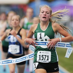 Olympus' Olivia Hoj wins the 1,600 meter race during the BYU Invitational track meet in Provo Saturday, May 7, 2016.