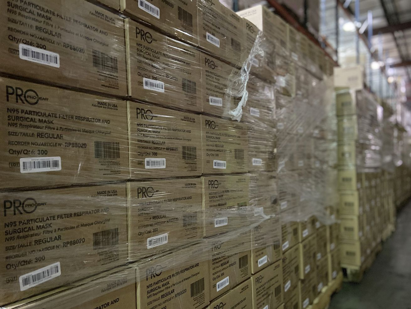 This photo from earlier this month provided by Prestige Ameritech shows boxes of the company's N95 masks in warehouse storage at North Richland Hills, Texas, outside of Fort Worth. One year into the COVID-19 pandemic, the U.S. finds itself with many millions of N95 masks pouring out of American factories and heading into storage. Yet there still aren't nearly enough in ICU rooms and hospitals