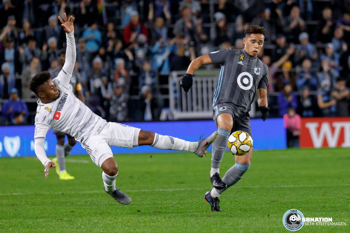 September 29, 2019 - Saint Paul, Minnesota, United States - LAFC defender Diego Palacios (12) lunges towards Minnesota United  midfielder Hassani Dotson (31) and the ball during a match at Allianz Field.