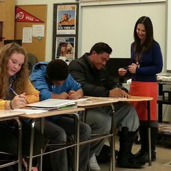 """Leigh VandenAkker, right, talks with student and East High School lineman Johnny Maea during her """"Techniques for Tough Times"""" class on Monday, Nov. 16."""