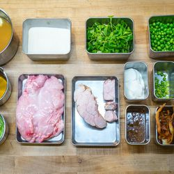 The ingredients: <br>(top row from left) veal stock, quick mixing flour, mache, fresh peas.<br> (middle row from left) vegetable stock, raw veal sweetbreads, poached veal sweetbreads, crème fraîche, English peas, mint.<br> (bottom row from left) pea pur