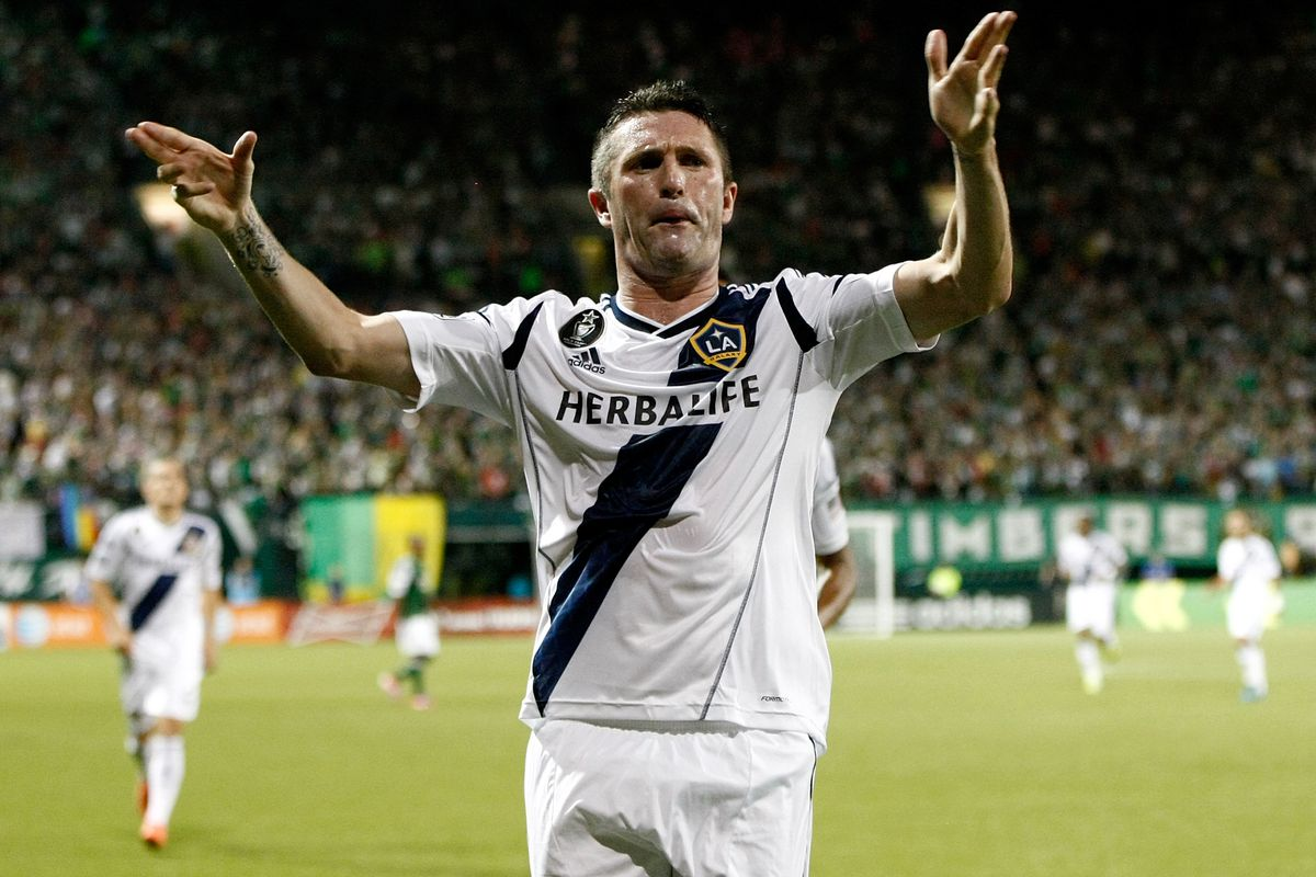 PORTLAND, OR - JULY 14:  Robbie Keane #7 of the Los Angeles Galaxy celebrates scoring a goal in the second half against the Portland Timbers on July 14, 2012 at Jeld-Wen Field in Portland, Oregon.  (Photo by Jonathan Ferrey/Getty Images)