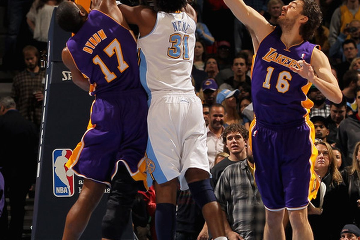 DENVER CO - JANUARY 21:  Nene #31 of the Denver Nuggets puts up a shot between Andrew Bynum #17 and Pau Gasol #16 of the Los Angeles Lakers at the Pepsi Center on January 21 2011 in Denver Colorado. (Photo by Doug Pensinger/Getty Images)