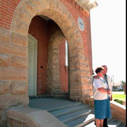 A couple has their picture taken on the steps of the Vernal Temple, the former Uintah Stake Tabernacle, in 1997.