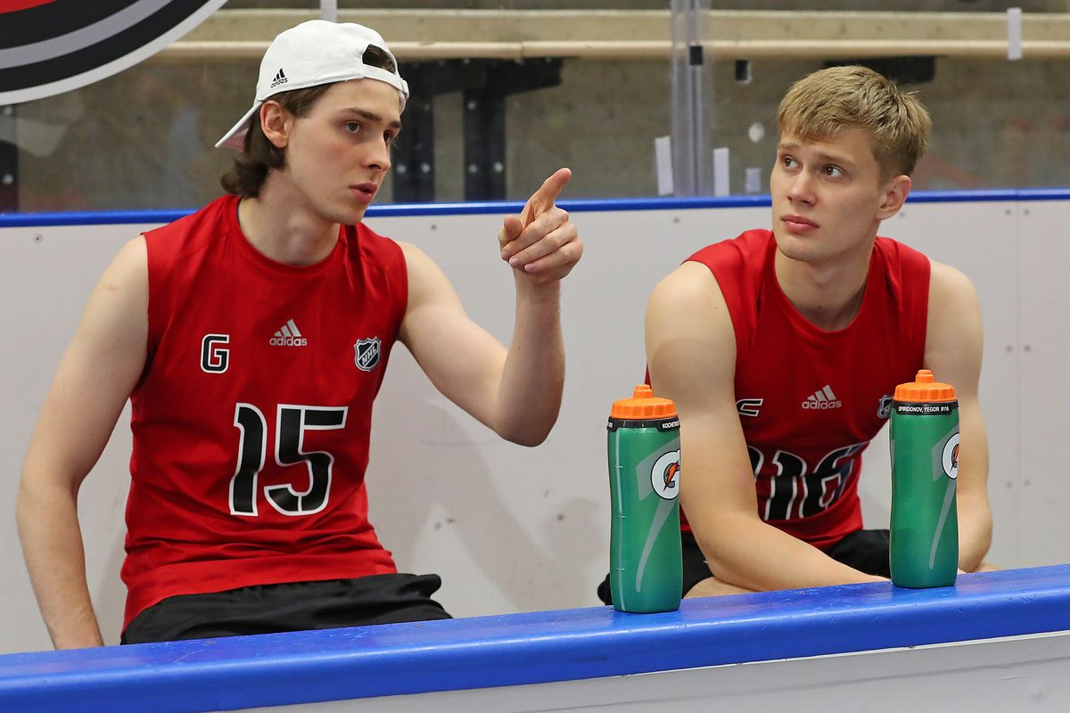 BUFFALO, NY - JUNE 1: Pyotr Kochetkov #15 and Yegor Spiridonov #116 chat during the 2019 NHL Scouting Combine on June 1, 2019 at Harborcenter in Buffalo, New York.