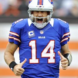 Buffalo Bills quarterback Ryan Fitzpatrick reacts after throwing a 9-yard touchdown pass to wide receiver Steve Johnson in the fourth quarter of an NFL football game against the Cleveland Browns, Sunday, Sept. 23, 2012, in Cleveland.