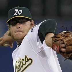 Oakland Athletics' A.J. Griffin works against the Seattle Mariners in the first inning of a baseball game Friday, Sept. 28, 2012, in Oakland, Calif.