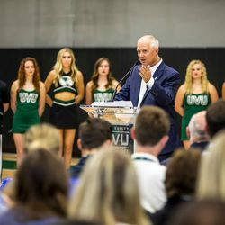 NUVI Chairman and CEO Keith Nellesen (center) speaks at the ribbon cutting ceremony for the NUVI Basketball Center on the campus of Utah Valley University.