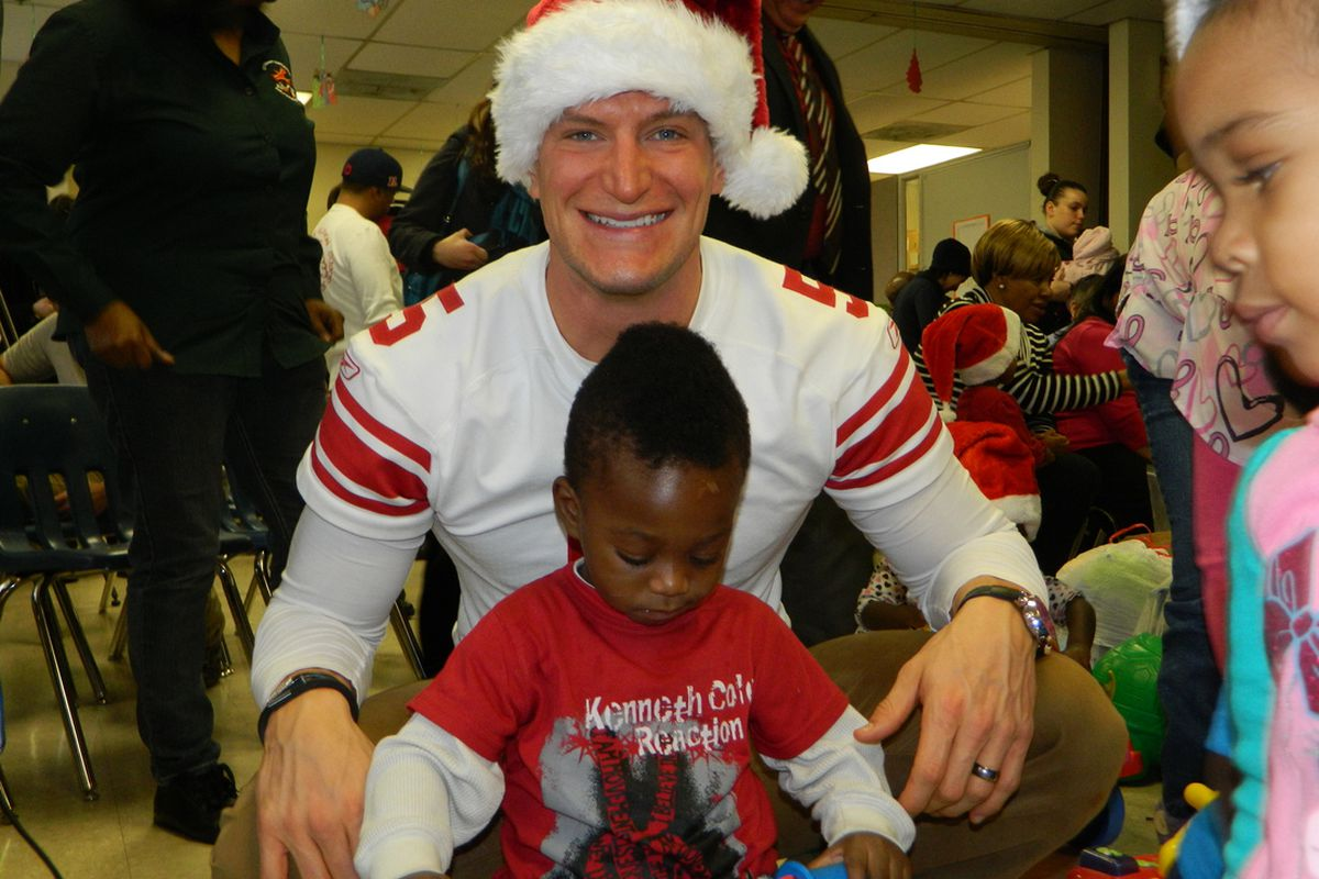 Giants' punter Steve Weatherford helped out at a toy drive in Newark on Tuesday