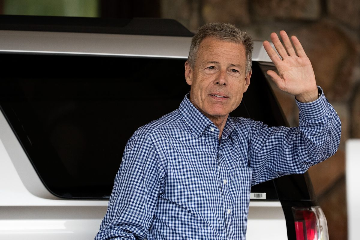 Time Warner CEO Jeff Bewkes waves as he gets out of his car in Sun Valley, Idaho.