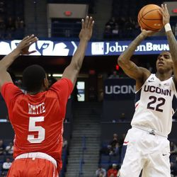 UConn's Terry Larrier (22) puts up a shot over BU's Walter Whyte (5).