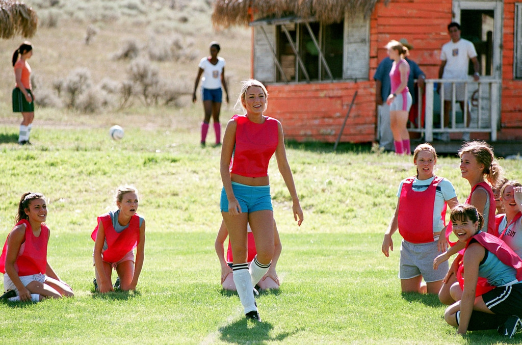 Young women playing soccer.