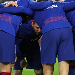 A Barca huddle before Messi hit a hat-trick against Real Mallorca
