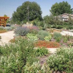 The Paul Rasmussen Teaching Garden features paths around the plants so that plants can be seen from all sides.