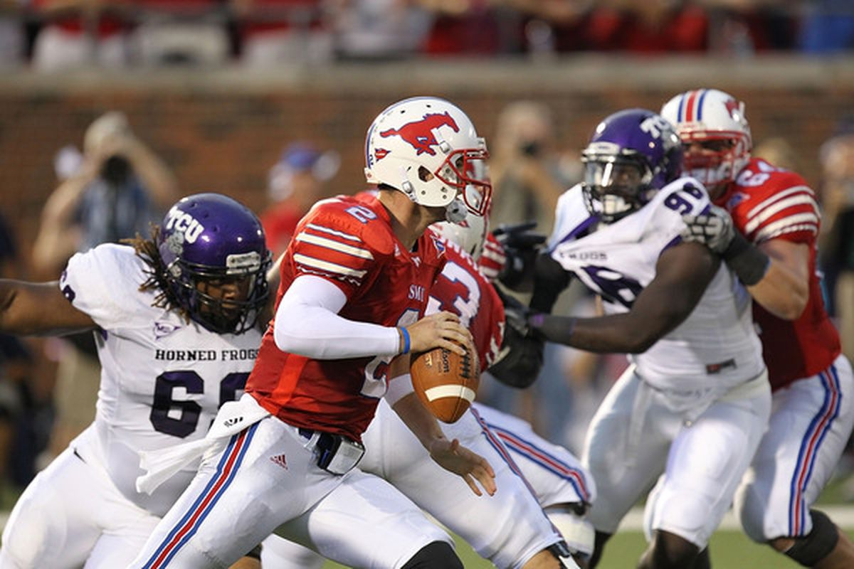 DALLAS - SEPTEMBER 24:  Quarterback Kyle Padron #2 of the SMU Mustangs looks to pass against the TCU Horned Frogs at Gerald J. Ford Stadium on September 24 2010 in Dallas Texas.  THROW THE BALL, KYLE.  (Photo by Ronald Martinez/Getty Images)
