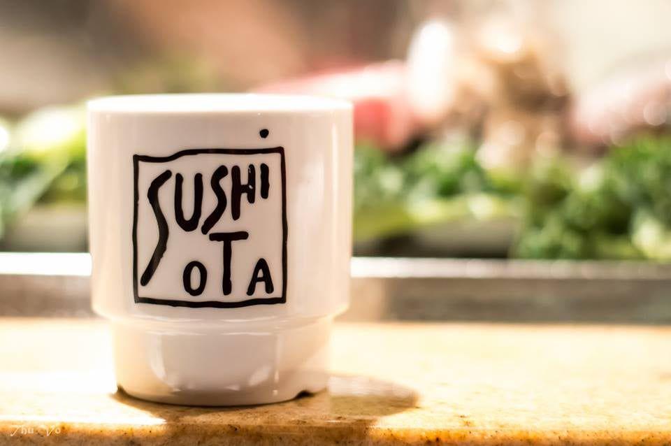 Tea cup on the sushi bar at Sushi Ota
