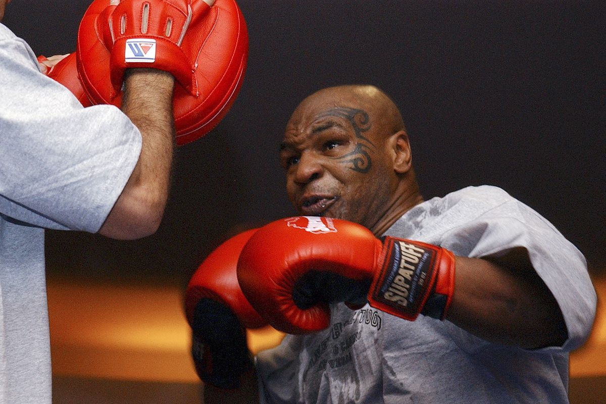 mike tyson returning to boxing with eight round exhibition vs roy jones jr chicago sun times exhibition vs roy jones jr