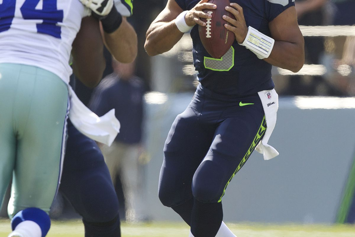 SEATTLE, WA - SEPTEMBER 16: Russell Wilson #3 .of the Seattle Seahawks drops back to pass during a game agains the Dallas Cowboys  at CenturyLink Field on September 16, 2012 in Seattle, Washington. (Photo by Stephen Brashear/Getty Images)