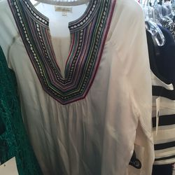 White shirt with multicolor v-neck, $65