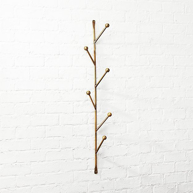 Vertical hanger with tree branch-like hooks.
