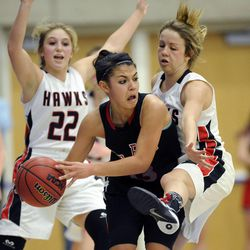American Fork's Taylor Moeaki (13) looks for an outlet while being defended by Alta's Rachel Jenson (5) during the state semi-finals at Salt Lake Community College on Friday, Feb. 28, 2014.