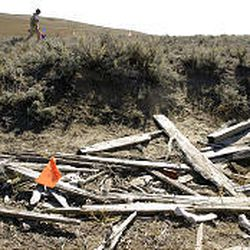 A hillside near Gillette, Wyo., is littered with the remnants of an old homestead.