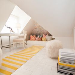"""This """"secluded writer's retreat"""" was designed by <a href=""""http://www.kristemichelini.com/"""">Kriste Michelini Interiors</a>. Whitewashed floors, grasscloth and pops of bright and pale warm colors complete the space. [Photo by <a href=""""http://www.patriciacha"""