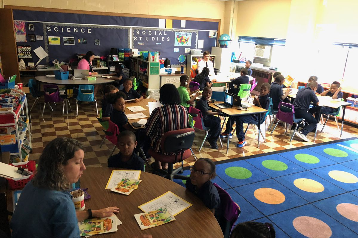 The third-grade classroom for struggling readers at Detroit Premier Academy was divided into stations.