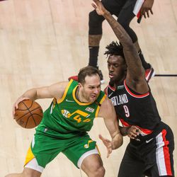 Utah Jazz forward Bojan Bogdanovic (44) moves with the ball against Portland Trail Blazer forward Nassir Little (9) during the game at Vivint Smart Home Arena in Salt Lake City on Thursday, April 8, 2021.