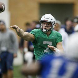 BYU quarterback Beau Hoge (7) throws during BYU football alumni day practice in Provo on Friday, March 31, 2017.