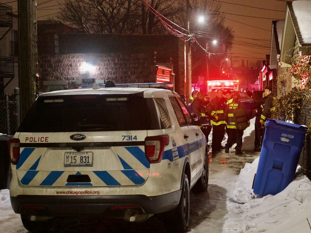 First responders congregate in an alley off the 900 block of South Bell where an off-duty female Chicago police officer was found fatally shot Saturday night. | Matthew Hendrickson/Sun-Times