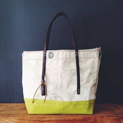 """San Francisco designer Susan Hoff's Original Hardware Sailcloth Tote, $320 at <a href=""""http://susanhoff.com/collections/in-the-shop/products/original-hardware-tote"""">Susan Hoff</a>, is roomy and eco-friendly: Hoff's totes are made from recycled sailcloth."""